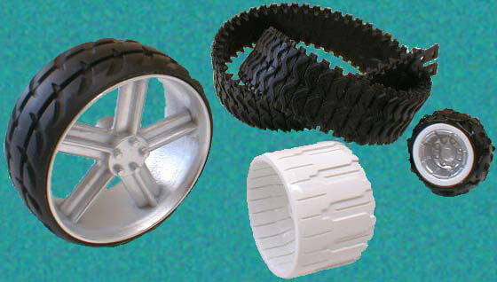 Master patterns were produced and vaccum cast to produce parts in a flexible resin to simulate rubber tyres and tracks.
