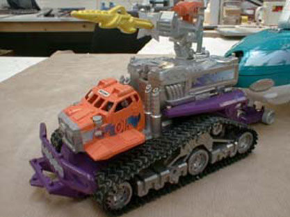 Arctic Exploration Mega Rig.  This photo is of the fully finished and painted lead tracked vehicle, with just the front of the submarine (shown above) visible being towed behind this prototype of the toy.