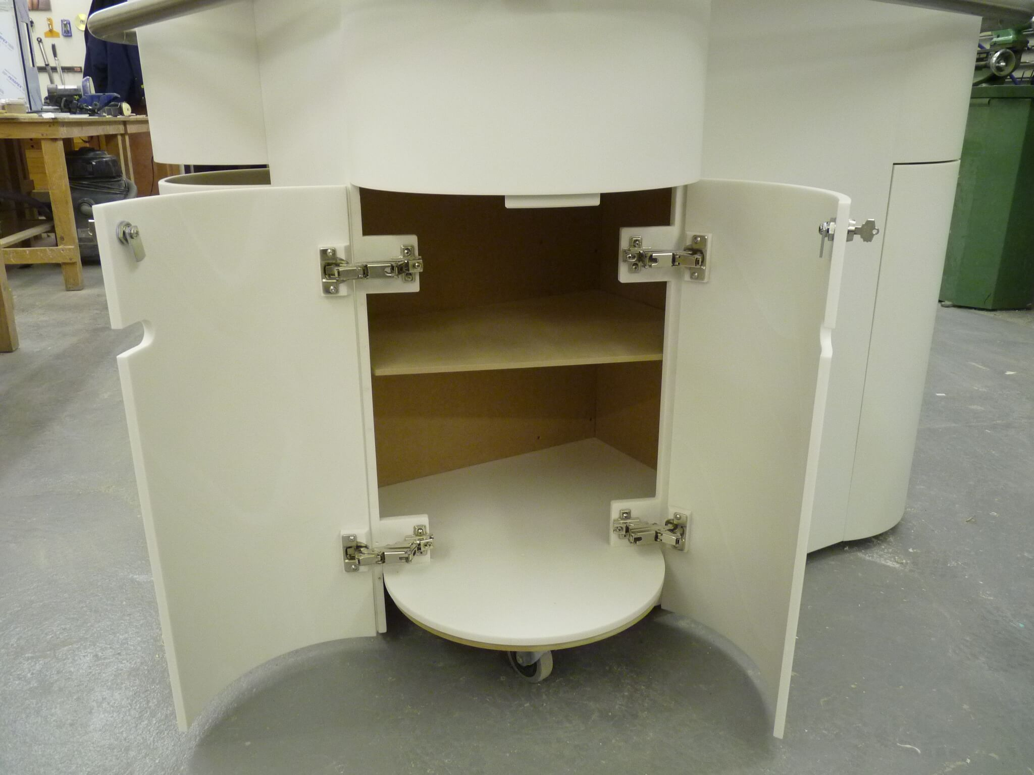 Wheeled Corain Point Of Sale Unit with concealed corner stool.