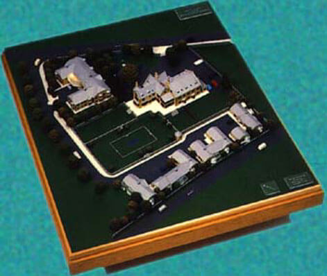 Client : Andrew Humphries Architects  1:200 scale model of a proposed retirement home in Stow on the wold.  The model showed the existing main building (centre) with proposed extension to the rear. The main gardens had to be retained as original.  (top left) New proposed secure retirement apartments.  (bottom of model) A small development of single storey bungalows.  Base size : 1000mm x 1000mm