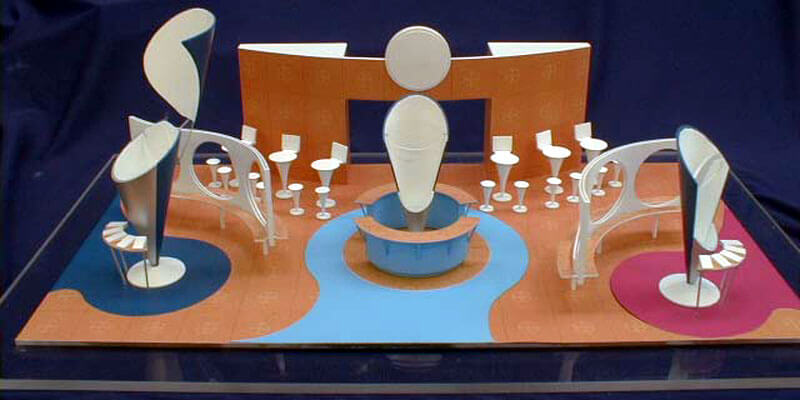 One of two different proposals for one exhibition pitch. Both models were fabricated from acrylic sheet, spray painted and the graphics were applied.  Scale 1:33