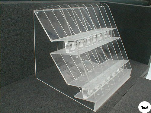 Cosmetics dispenser for the counter top display of lipsticks.  Fabricated from clear acrylic sheet and a textured frosted effect applied..  End client Boots.