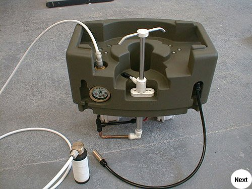 Working model of a water purification system developed for the armed services to use out in the field where fresh drinking water is unavailable.  Base and top made from glass fibre and resin. Actual components were fitted to the mouldings and taken for testing.