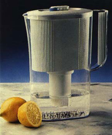 This model was an appearance model for Britta water filters.  A male former was produced for each half of the jug, acrylic sheet was heat formed around trimmed to size and bonded together.  The white filter section was machined from solid.
