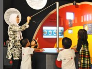 How to weigh a galaxy interative in use  See even adults are attracted to our exhibits!  Astrophysicists and seven-year-olds seem to find this exhibit equally stimulating...
