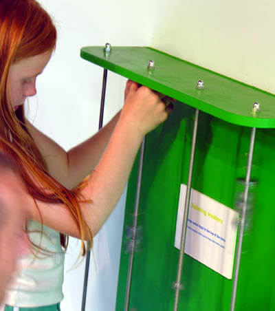 Children move the washers up the threaded steel rods to the top and can watch then spin rapidly as they slowly make their way back down.
